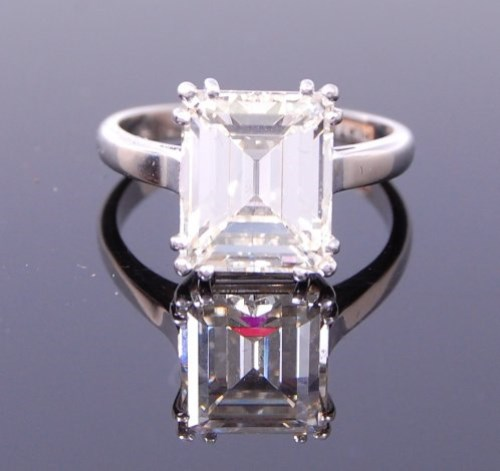 Lot 3268-A platinum diamond single stone ring, the emerald ...