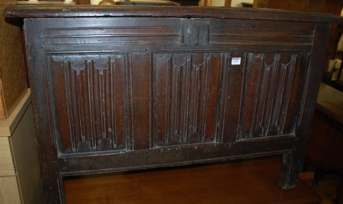 Lot 1399-A late 17th century joined oak three panelled...