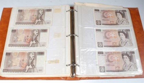 Lot 216-A folder of approx 120 British banknotes to...