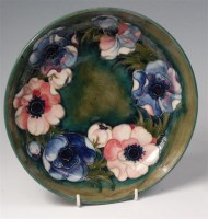 Lot 5 - An early 20th century Moorcroft painted and...