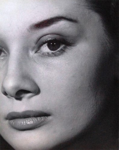 Lot 57-Angus McBean - Audrey Hepburn, close-up portrait...