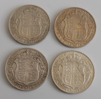 Lot 2011-Great Britain, four George V half crowns, dated...