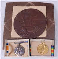 Lot 33-A WW I Casualty group to include a bronze...