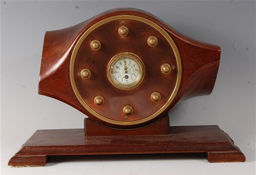Lot 3-An early 20th century propeller mantel clock,...