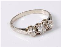 Lot 2519-An 18ct three stone diamond ring, the three round ...