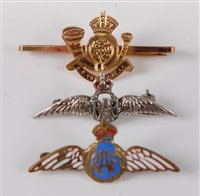 Lot 48-A 9ct gold sweetheart brooch for the King's Own...
