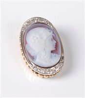 Lot 2501-A 14ct diamond set cameo pendant, the oval shell...
