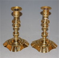 Lot 33-A pair of 18th century brass candlesticks with...