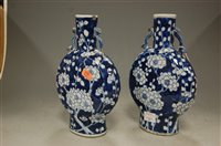 Lot 11-A pair of Chinese export blue and white moon...