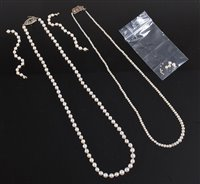 Lot 2511-Two cultured pearl necklaces with diamond set...