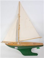 Lot 26-A wooden and tinplate model of a sailing yacht...