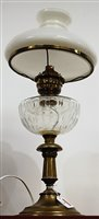 Lot 6-An early 20th century oil lamp, having opalescent ...
