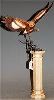 Lot 16-A Franklin Mint model of an eagle perched on a...