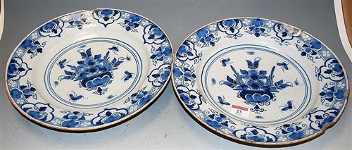 Lot 23-A pair of 18th century Delft blue and white...