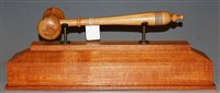 Lot 28-An oversized turned sycamore gavel, raised on an...