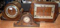 Lot 43-An Art Deco oak cased mantel clock having 8-day...