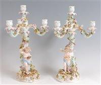 Lot 1080 - A pair of circa 1900 German porcelain four...