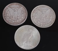 Lot 2023-USA, 1900 silver Morgan dollar, together with a...