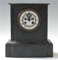 Lot 2-A late Victorian black slate mantel clock, of...