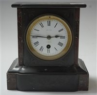 Lot 3-A late Victorian black slate and rouge marble...