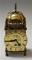 Lot 4-A brass cased lantern clock, in the 17th century...