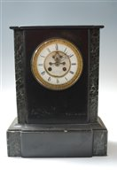 Lot 5-A late 19th century black slate and green marble...