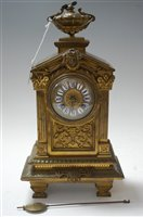 Lot 9-A late 19th century brass cased mantel clock, of...