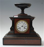 Lot 12-A late 19th century black slate and rouge marble...