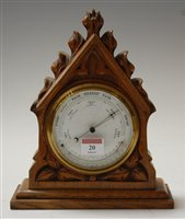 Lot 20-A late Victorian carved oak cased barometer,...