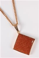 Lot 2506-A goldstone pendant and 9ct chain, the square of...