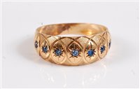 Lot 2516-A seven stone gemset ring, the seven small blue...