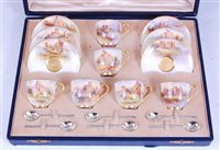 Lot 1027-*A cased set of six Royal Worcester coffee cups...