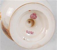 Lot 1037-*A Royal Worcester porcelain twin handled vase...