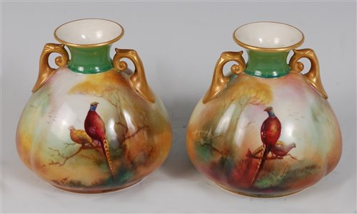 Lot 1040-*A pair of Royal Worcester twin handled...