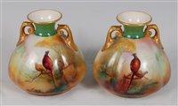 Lot 1040-*A pair of Royal Worcester twin handled porcelain ...