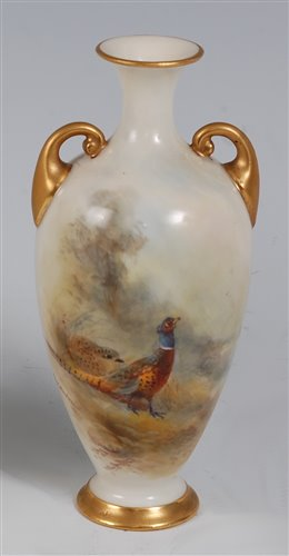 Lot 1042-*A Royal Worcester porcelain twin handled vase,...
