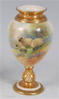 Lot 1044-*A Royal Worcester porcelain ovoid pedestal vase, ...