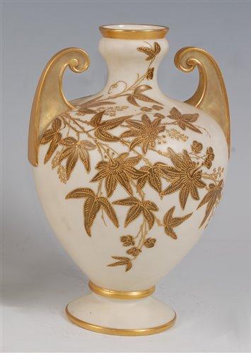 Lot 1055 - *A Royal Worcester porcelain twin handled vase,...