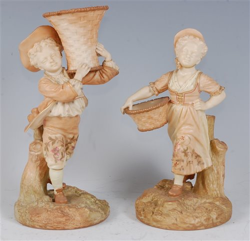 Lot 1058 - *A pair of Royal Worcester blush ivory figures,...