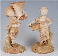 Lot 1058-*A pair of Royal Worcester blush ivory figures,...