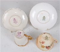 Lot 1065 - *A Royal Worcester reticulated cabinet cup and...