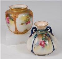 Lot 1057 - *A small Royal Worcester porcelain squat vase,...