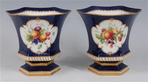 Lot 1061 - *A pair of Royal Worcester porcelain vases,...