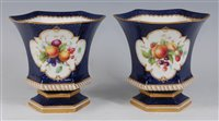 Lot 1061-*A pair of Royal Worcester porcelain vases, each...