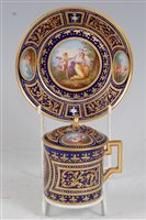 Lot 1074-*A 19th century Vienna porcelain chocolate cup...