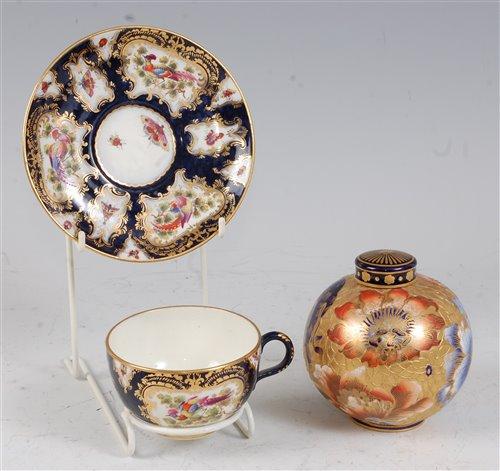 Lot 1066 - *A Royal Worcester porcelain teacup and saucer,...