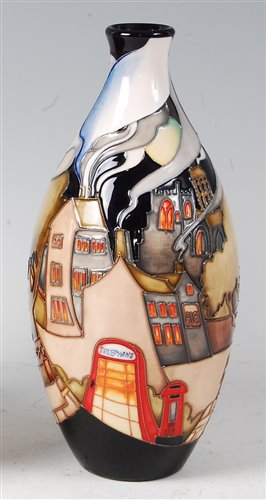 Lot 2-A Moorcroft pottery vase in the Village pattern,...