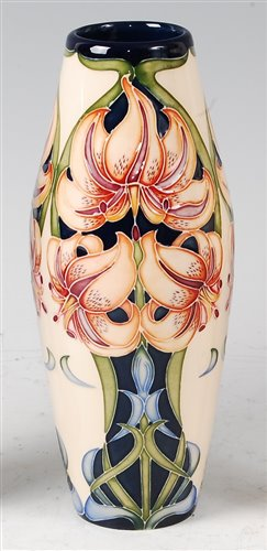 Lot 4-A Moorcroft pottery vase in the Lily pattern...