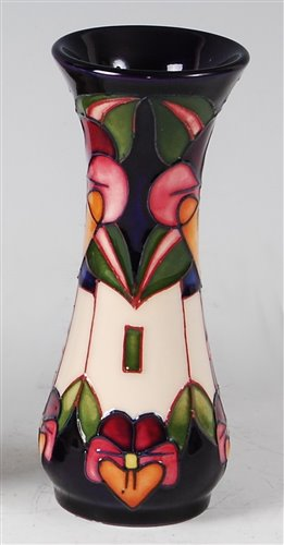 Lot 11-A small Moorcroft pottery vase in the Trilogy...