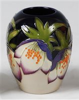 Lot 13-A small Moorcroft pottery vase in the Purple...